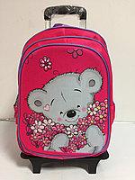 Школьный рюкзак на колесах для девочек с 1-го по 3-й класс.Высота 45 см, длина 30 см, ширина 21 см.