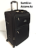 Средний тканевый дорожный чемодан на 4-х колесах Polo Collection. Высота 65 см, длина 42 см, ширина 28 см.