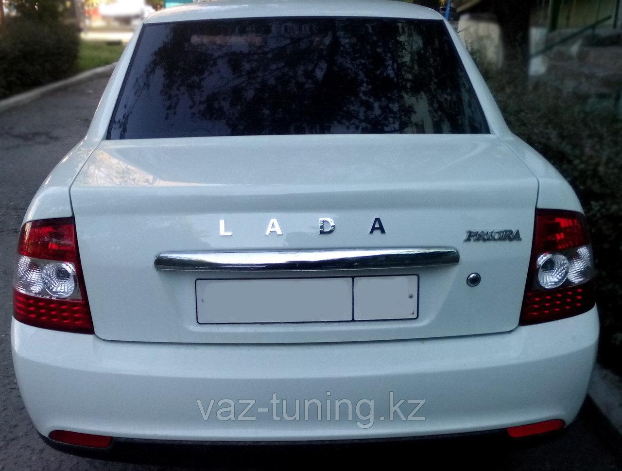 Эмблема L A D A